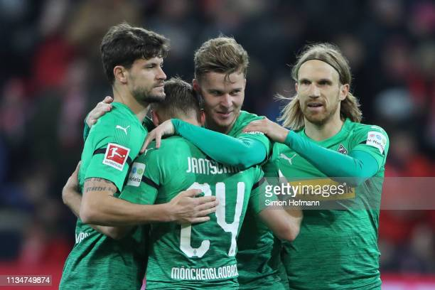 Nico Elvedi of Borussia Monchengladbach celebrates victory with teammates Tony Jantschke Tobias Strobl and Michael Lang after the Bundesliga match...