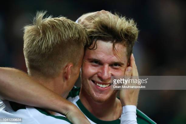 Nico Elvedi of Borussia Monchengladbach celebrates with a team mate after scoring his side's third goal during the Bundesliga match between Borussia...