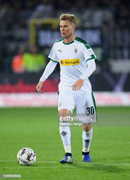 Nico Elvedi of Borussia Monchengladbach runs with the ball during the Bundesliga match between SportClub Freiburg and Borussia Moenchengladbach at...