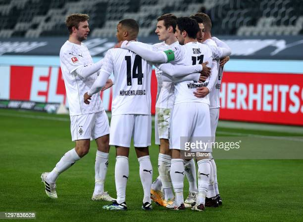 Nico Elvedi of Gladbach celebrate with his team mates after he scores the opening goal during the Bundesliga match between Borussia Moenchengladbach...