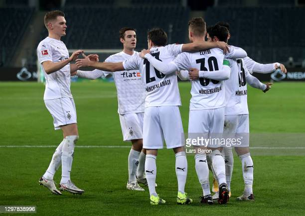 Nico Elvedi of Gladbach celebrate with his team mates after he scores his team's 2nd goal during the Bundesliga match between Borussia...