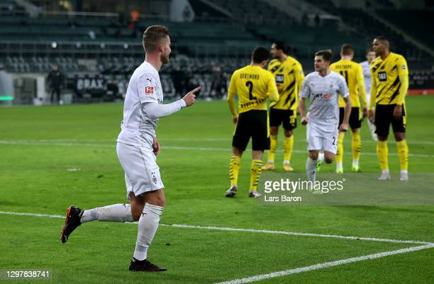 Nico Elvedi of Gladbach celebrates after he scores his tream's 2nd goal during the Bundesliga match between Borussia Moenchengladbach and Borussia...