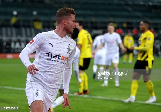 Nico Elvedi of Gladbach celebrates after he scores the opening goal during the Bundesliga match between Borussia Moenchengladbach and Borussia...