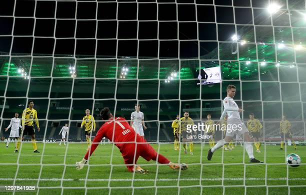 Nico Elvedi of Gladbach scores his team's 2nd goal during the Bundesliga match between Borussia Moenchengladbach and Borussia Dortmund at...