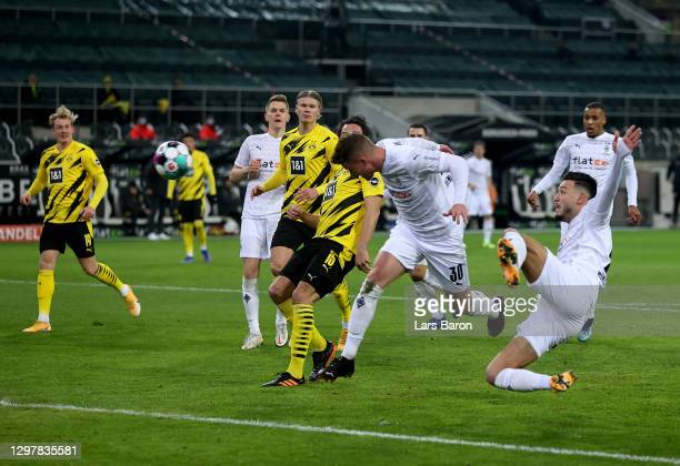 Nico Elvedi of Gladbach scores the opening goal during the Bundesliga match between Borussia Moenchengladbach and Borussia Dortmund at Borussia-Park...