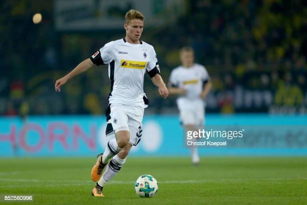 Nico Elvedi of Mnchengladbach runs with the ball during the Bundesliga match between Borussia Dortmund and Borussia Moenchengladbach at Signal Iduna...
