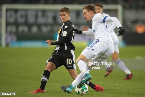 Nico Elvedi of Moenchengladbach and Bastian Oczipka of Schalke battle for the ball during the Bundesliga match between Borussia Moenchengladbach and...