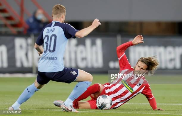 Nico Elvedi of Moenchengladbach and Lucas Hoeler of Freiburg in action during the Bundesliga match between SportClub Freiburg and Borussia...