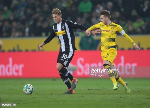 Nico Elvedi of Moenchengladbach and Marco Reus of Dortmund battle for the ball during the Bundesliga match between Borussia Moenchengladbach and...