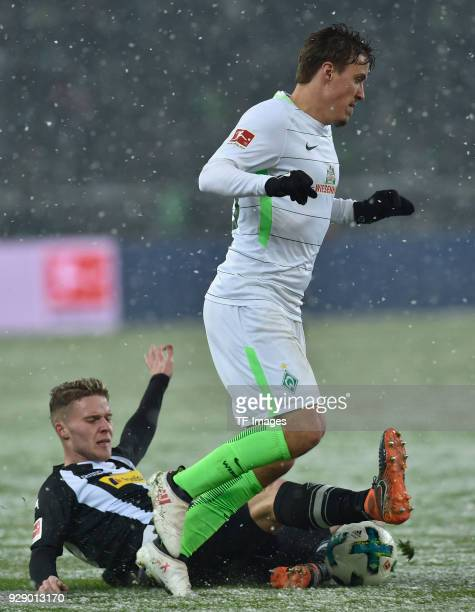 Nico Elvedi of Moenchengladbach and Max Kruse of Bremen battle for the ball during the Bundesliga match between Borussia Moenchengladbach and Werder...