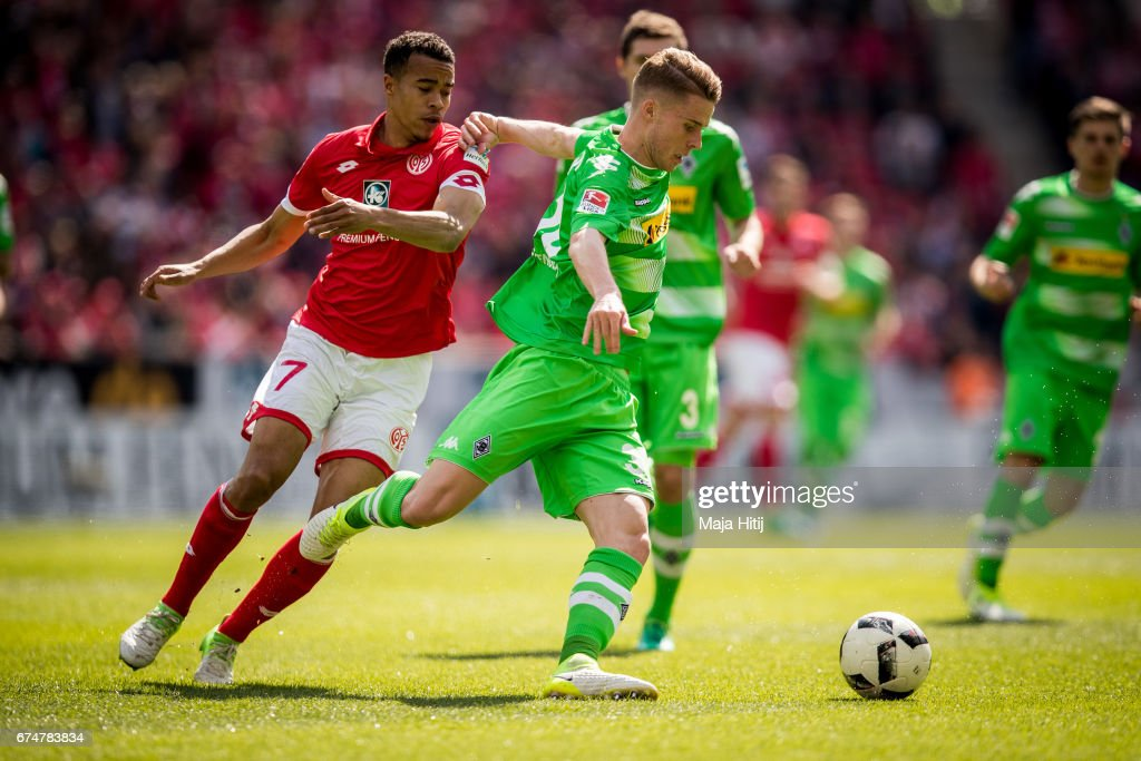 Nico Elvedi of Moenchengladbach and Robin Quaison of Mainz battle for the ball during the Bundesliga match between 1. FSV Mainz 05 and Borussia Moenchengladbach at Opel Arena on April 29, 2017 in Mainz, Germany.