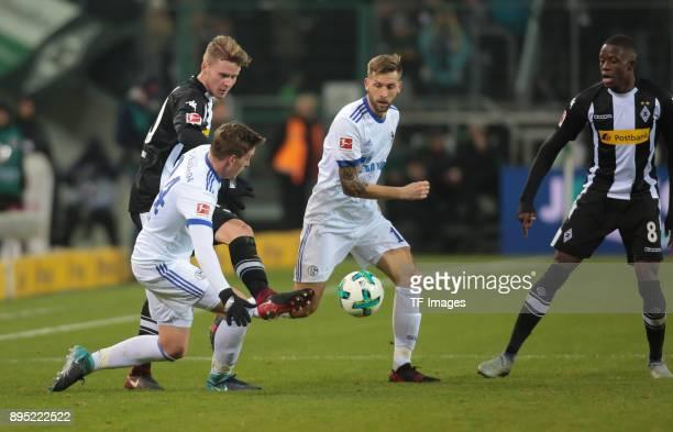 Nico Elvedi of Moenchengladbach Bastian Oczipka of Schalke and Guido Burgstaller of Schalke battle for the ball during the Bundesliga match between...