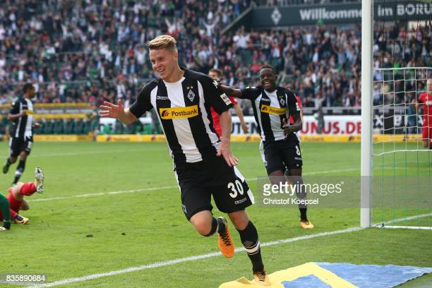 Nico Elvedi of Moenchengladbach celebrates having scored his teams first goal during the Bundesliga match between Borussia Moenchengladbach and 1 FC...