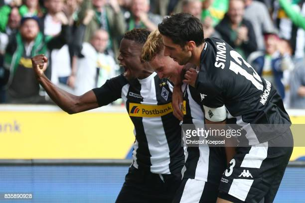 Nico Elvedi of Moenchengladbach celebrates having scored his teams first goal with Ibrahima Traore of Moenchengladbach and Lars Stindl of...