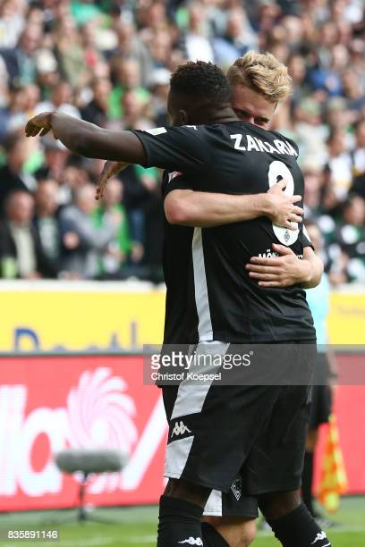 Nico Elvedi of Moenchengladbach celebrates having scored his teams first goal with Denis Zakaria of Moenchengladbach during the Bundesliga match...