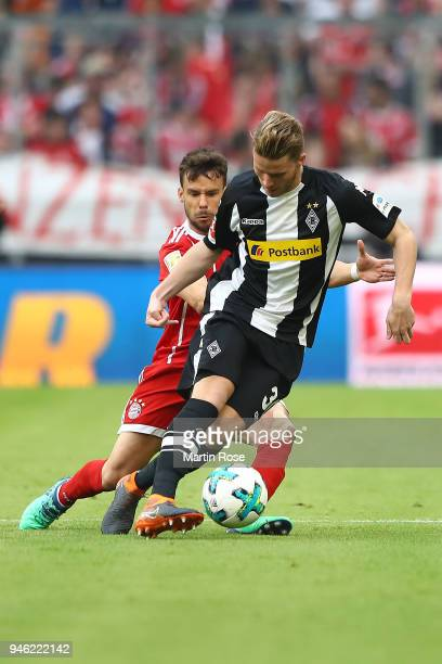 Nico Elvedi of Moenchengladbach fights for the ball with Juan Bernat of Bayern Muenchen during the Bundesliga match between FC Bayern Muenchen and...