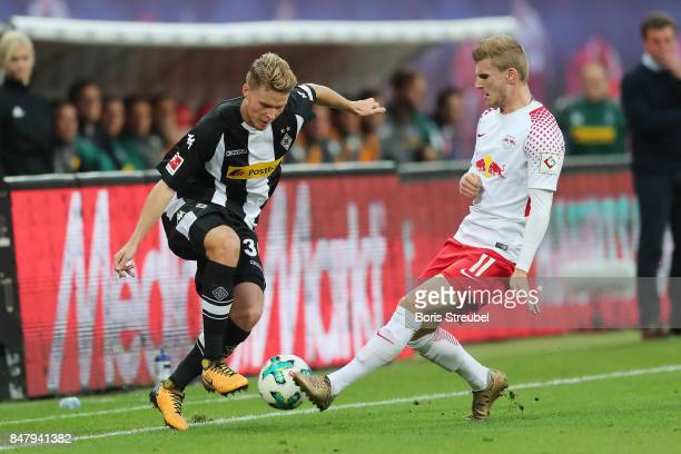 Nico Elvedi of Moenchengladbach fights for the ball with Timo Werner of Leipzig Nicoduring the Bundesliga match between RB Leipzig and Borussia...