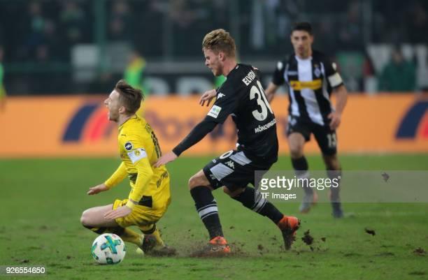 Nico Elvedi of Moenchengladbach fouls Marco Reus of Dortmund during the Bundesliga match between Borussia Moenchengladbach and Borussia Dortmund at...