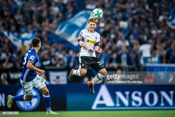 Nico Elvedi of Moenchengladbach heads the ball during the Bundesliga match between FC Schalke 04 and Borussia Moenchengladbach at VeltinsArena on...