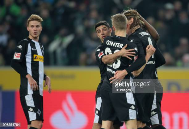 Nico Elvedi of Moenchengladbach hugs Lars Stindl of Moenchengladbach during the Bundesliga match between Borussia Moenchengladbach and Borussia...