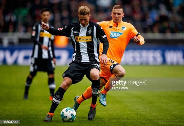 Nico Elvedi of Moenchengladbach is challenged by Pavel Kaderabek of Hoffenheim during the Bundesliga match between Borussia Moenchengladbach and TSG...
