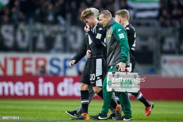 Nico Elvedi of Moenchengladbach is injured during the Bundesliga match between 1 FSV Mainz 05 and Borussia Moenchengladbach at Opel Arena on April 1...