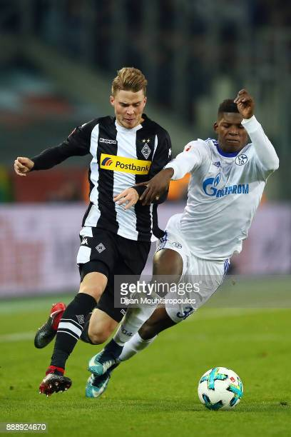 Nico Elvedi of Moenchengladbach runs for the ball with Breel Embolo of Schalke during the Bundesliga match between Borussia Moenchengladbach and FC...