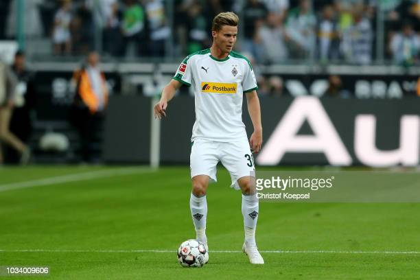 Nico Elvedi of Moenchengladbach runs with the ball during the Bundesliga match between Borussia Moenchengladbach and FC Schalke 04 at BorussiaPark on...