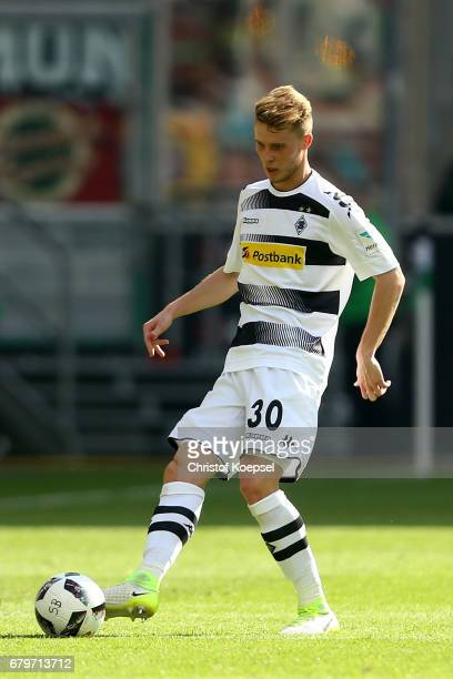 Nico Elvedi of Moenchengladbach runs with the ball during the Bundesliga match between Borussia Moenchengladbach and FC Augsburg at BorussiaPark on...