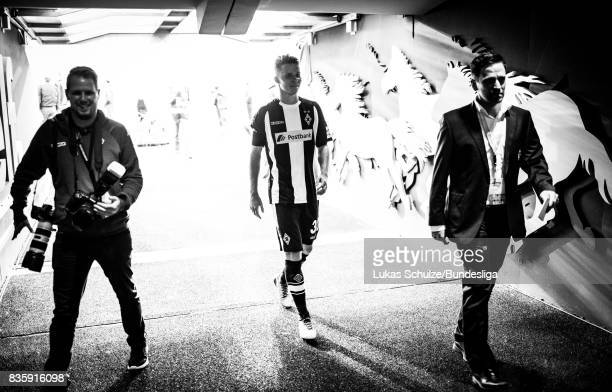 Nico Elvedi of Moenchengladbach scorer of the goal leaves the pitch trough the tunnel after winning the Bundesliga match between Borussia...