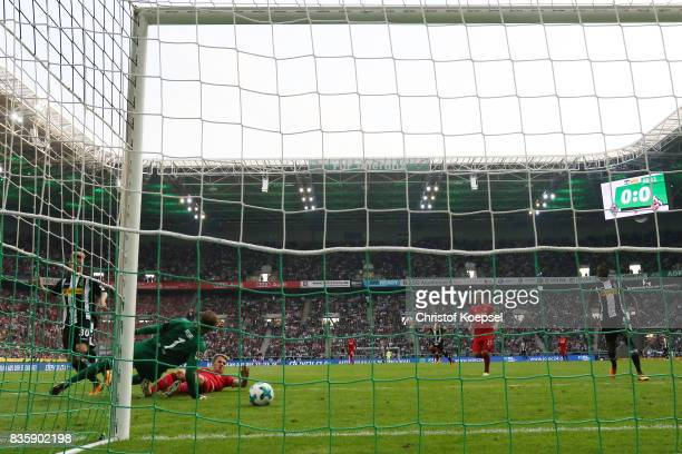 Nico Elvedi of Moenchengladbach scores his teams first goal past goalkeeper Timo Horn of Koeln during the Bundesliga match between Borussia...