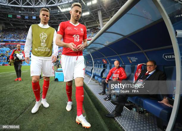 Nico Elvedi of Switzerland and Josip Drmic of Switzerland look dejected following their sides defeat in the 2018 FIFA World Cup Russia Round of 16...
