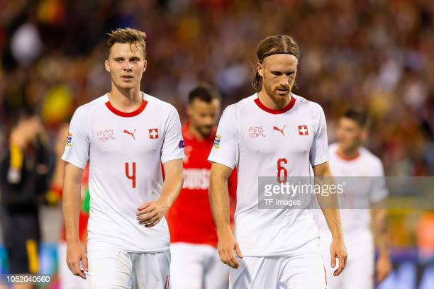 Nico Elvedi of Switzerland and Michael Lang of Switzerland look dejected after the UEFA Nations League A group two match between Belgium and...