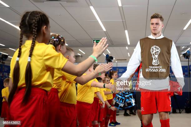 Nico Elvedi of Switzerland greets mascots in the tunnel prior to the 2018 FIFA World Cup Russia group E match between Switzerland and Costa Rica at...