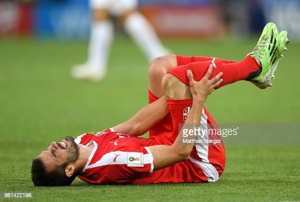 Nico Elvedi of Switzerland lies on the pitch injured during the 2018 FIFA World Cup Russia group E match between Serbia and Switzerland at...