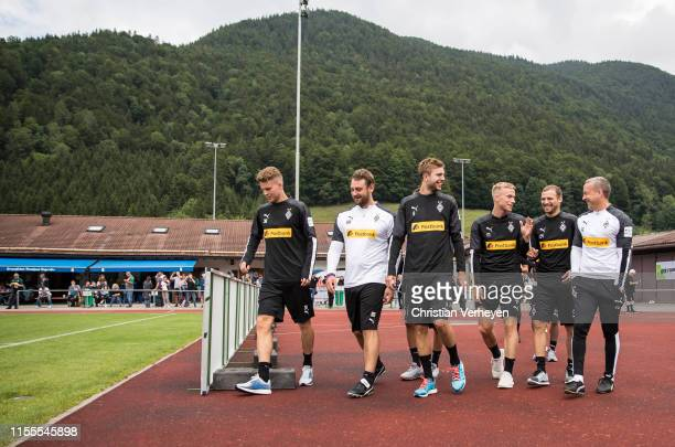 Nico Elvedi Rene Maric Christoph Kramer Oscar Wendt Tony Jantschke and Frank Geideck of Borussia Moenchengladbach enter the Training pitch during the...