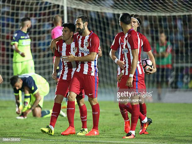 Nico Gaitan of Atletico de Madrid celebrates after scoring his team's opening goal during a preseason friendly match between FC Crotone and Club...