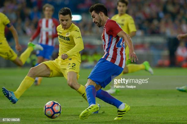 Nico Gaitan of Atletico de Madrid fights the ball with Antonio Rukavina of Villareal during a match between Atletico Madrid v Villarreal as part of...