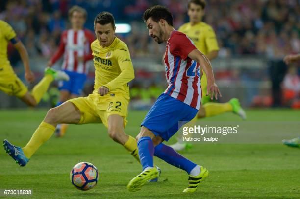 Nico Gaitan of Atletico de Madrid fights the ball with Antonio Rukavina of Villareal during a match between Atletico Madrid v Villarreal as part of...