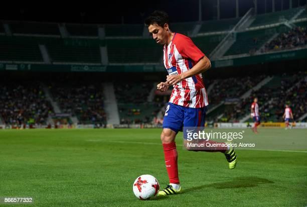 Nico Gaitan of Atletico de Madrid runs with the ball during the Copa del Rey first leg match between Elche CF and Atletico de Madrid at Estadio...