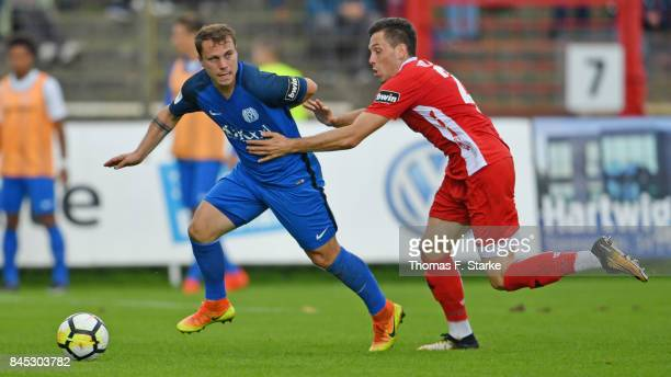Nico Granatowski of Meppen and Marcel Baer of Aalen fight for the ball during the 3 Liga match between SV Meppen and VfR Aalen at Haensch Arena on...