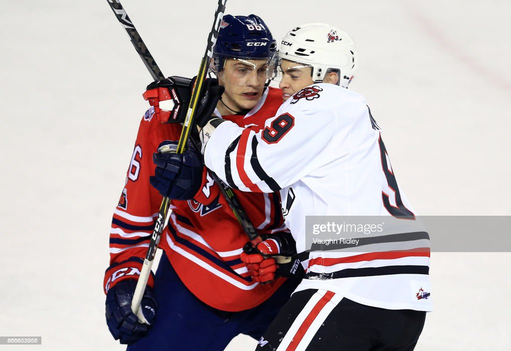 Nico Gross #66 of the Oshawa Generals and Joshua Dame #9 of the Niagara IceDogs battle in front of the net during an OHL game at the Meridian Centre on October 26, 2017 in St Catharines, Ontario, Canada.