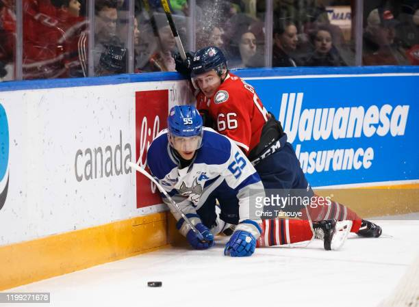 Nico Gross of the Oshawa Generals checks Quinton Byfield of the Sudbury Wolves during an OHL game at the Tribute Communities Centre on February 7,...