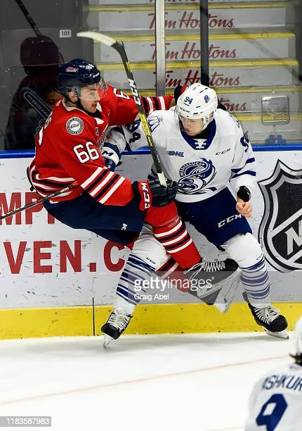 Nico Gross of the Oshawa Generals skates against Aidan Prueter of the Mississauga Steelheads during game action on October 25 2019 at Paramount Fine...
