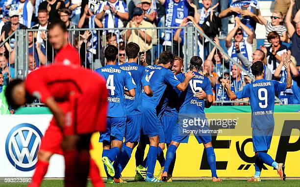 Nico Hammann of Magdeburg celebrates after scoring his team's first goal with team mates during the DFB Cup match between 1 FC Magdeburg and...