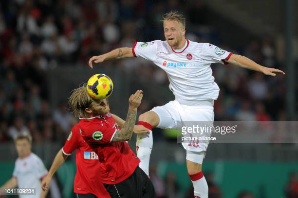 Nico Herzig of Wiesbaden and Philipp Hofmann of Kaiserslautern vie for the ball during penalty shootout during the DFB Cup 1st Round soccer match SV...