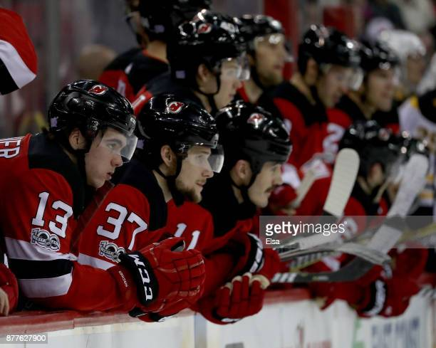 Nico Hischier and Pavel Zacha of the New Jersey Devils watch the shootout with the rest of their teammates on November 22 2017 at Prudential Center...