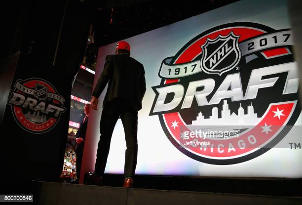Nico Hischier first overall pick of the New Jersey Devils makes his way to the stage during the 2017 NHL Draft at United Center on June 23 2017 in...