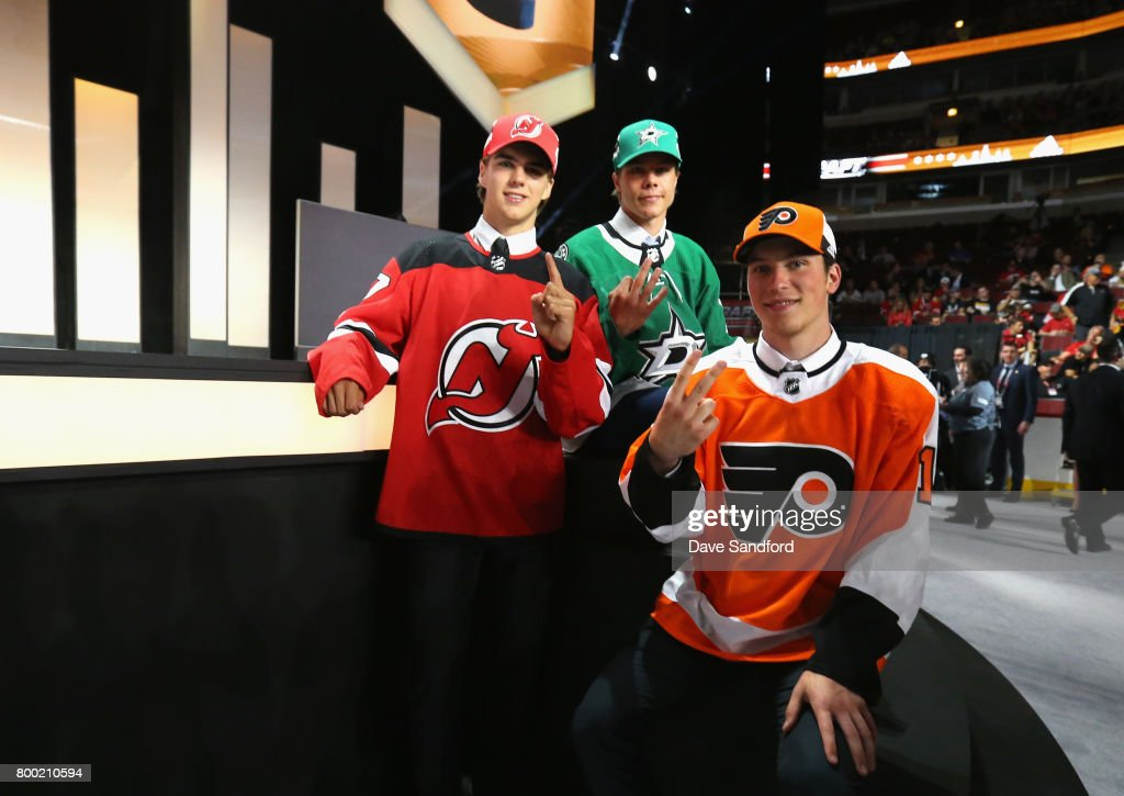 Nico Hischier, first overall pick of the New Jersey Devils, Miro Heiskanen, third overall pick of the Dallas Stars, and Nolan Patrick, second overall pick of the Philadelphia Flyers, pose for a photo near the stage during Round One of the 2017 NHL Draft at United Center on June 23, 2017 in Chicago, Illinois.