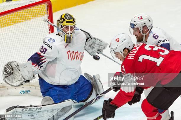 Nico Hischier of Switzerland tries to score against Goalie Henrik Holm and Jonas Holos of Norway during the 2019 IIHF Ice Hockey World Championship...